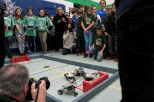Students competing in robotics battle